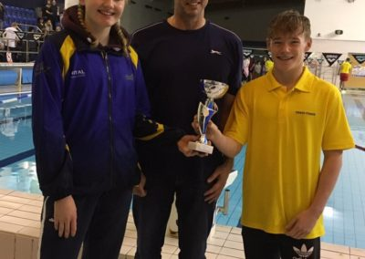 Captain Lucy with chair of Leicester League and David collecting third place trophy